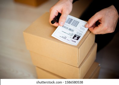 Delivery service, applying a shipping labe