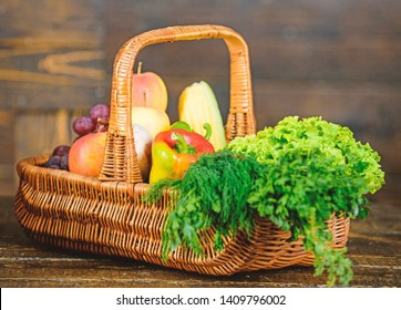 Delivery service fresh vegetables from farm. Buy fresh homegrown vegetables. Excellent quality vegetables. Box or basket harvest vegetables wooden background. Grocery shop concept. Just from garden.