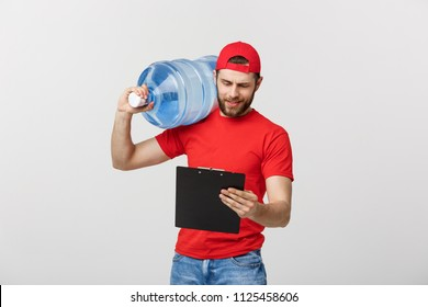 delivery service and people concept - happy man or courier with bottle of water and document with serious facial expression.