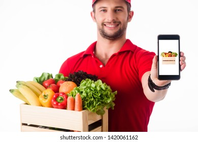 Delivery staff presenting smartphone with picture of food for order and delivery online, online food deliver conceptual