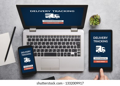 Delivery tracking concept on laptop, tablet and smartphone screen over gray table. Flat lay