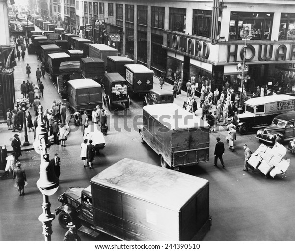 Delivery trucks jamming West 37th Street looking west from 7th Avenue New York City 1945.