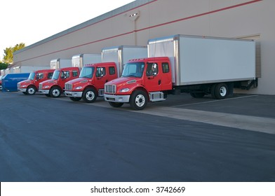 Delivery trucks at loading docks