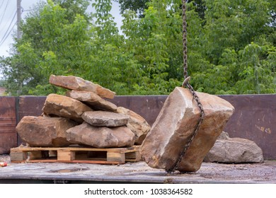 Delivery and unloading of building stone by truck with a crane