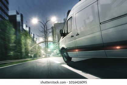 Delivery van drives in illuminated city