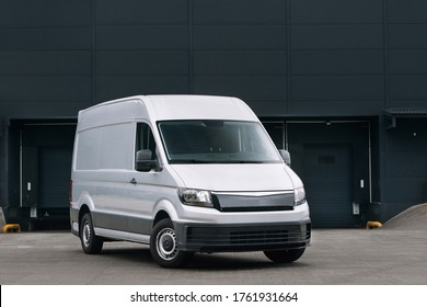 Delivery van near warehouse at logistic park