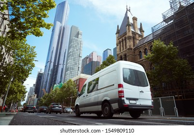 Delivery white van in the city street