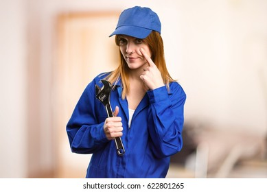 Delivery woman showing something on defocused background