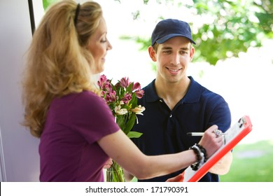 Delivery: Woman Signing For Flower Delivery