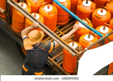 delivery worker with gas butane bottles , lgp gpl