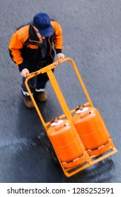 delivery worker with gas butane bottles , lpg  glp