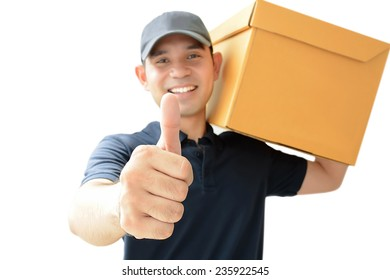 Deliveryman carrying a cardboard box giving thumbs up