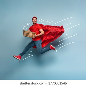 Deliveryman with pizzas acts like a powerful superhero. Concept of success and guarantee on shipment. Studio cyan background