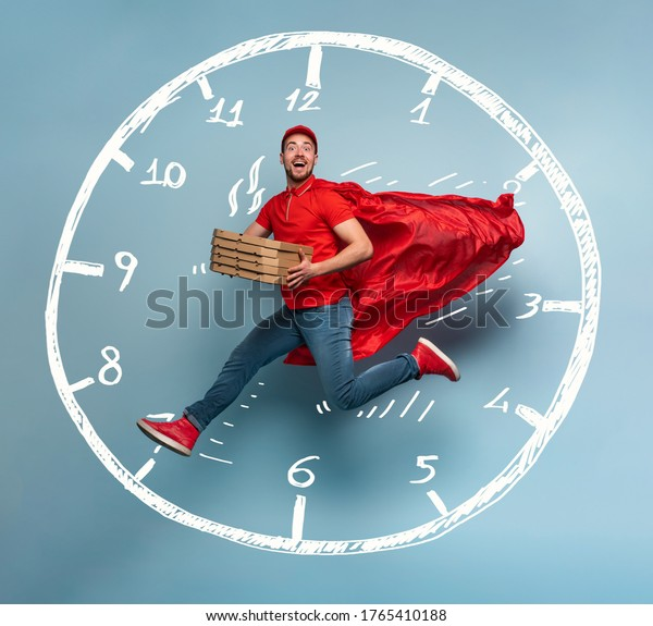 Deliveryman with pizzas acts like a powerful superhero. Concept of rapidity and guarantee on shipment. Studio cyan background