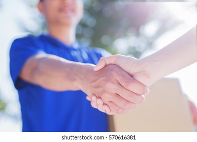 deliveryman stand and shake hand, asian