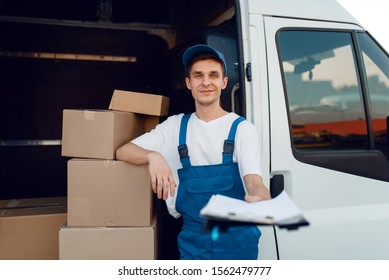 Deliveryman in uniform holding parcel, delivery