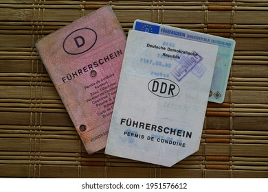 Delligsen, Germany, March 7th 2021 - the old GDR driving license, the pink driving license and the driving license in card form from Germany