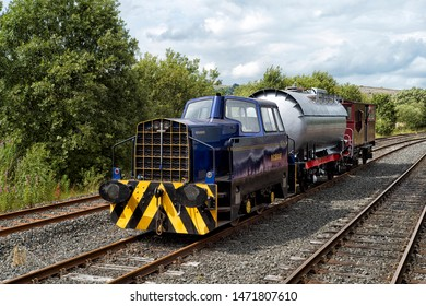 Delmellington, Ayrshire/Scotland-August 4th 2019:  goods train hauled by Sentinel Locomotive 10012 at Dunskin site of the former Brickwork's in which this locomotive was the only diesel to work there.