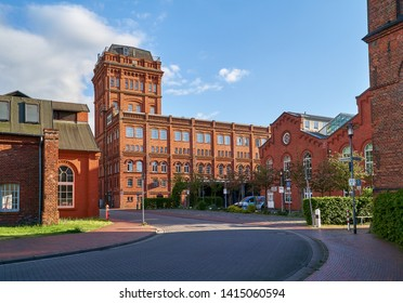"""Delmenhorst. Germany - May 03, 2019: big brick buildings on the site of the former worsted spinning mill, today the industrial monument """"Nordwolle"""" on a sunny spring day"""