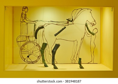 DELPHI, GREECE - APRIL 17, 2009: Outline drawing depicting the Heniokhos charioteer bronze composition with the surviving archaeological fragments at the archaeological museum of Delphi