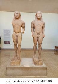 DELPHI, GREECE - MARCH 1, 2020: Kleobis and Biton, two Archaic Greek Kouros brothers from Argos, inside Delphi Archaeological Museum. Delphi, Boeotia, Greece, Europe