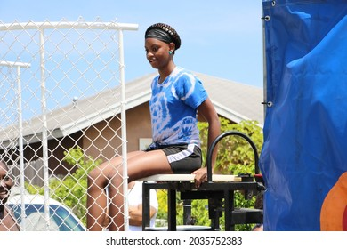 Delray Beach, Florida USA Aug 6 2016: The New Frog Alley Guns Down Kids up neighborhood event on sw 6th ave Girl on dunk tank