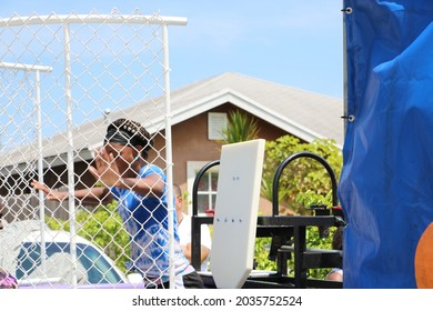 Delray Beach, Florida USA Aug 6 2016: The New Frog Alley Guns Down Kids up neighborhood event on sw 6th ave girl Dunk tank