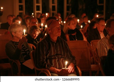DELRAY BEACH, FLORIDA / USA - DECEMBER 24 2018:  Parishoners in a congregation enjoy a candle-lighting ceremony in honor of the birth of Jesus Christ on Christmas eve.