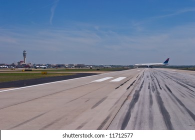 Delta aircraft exiting the runway at Hartsfield-Jackson Atlanta International Airport
