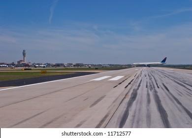 Delta aircraft exiting the runway at Hartsfield-Jackson Atlanta International Airport