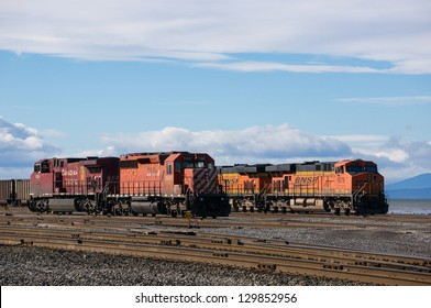 DELTA, BC, CANADA - FEBRUARY 16, 2013: Two locomotives on standby at Deltaport freight yard in Delta on February 16, 2013. Deltaport is Port Metro Vancouver's largest container terminal.