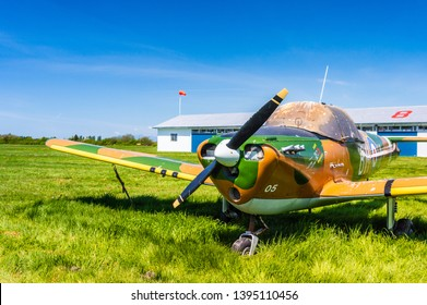 Delta, BC - May 7, 2019: Single engine propeller plane with camoflage style paint stored at Delta Heritage Airpark.