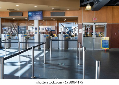 Delta, British Columbia, Canada - Apr 14 2021 : BC Ferries Tsawwassen ferry terminal ticket booth during covid-19 pandemic period.