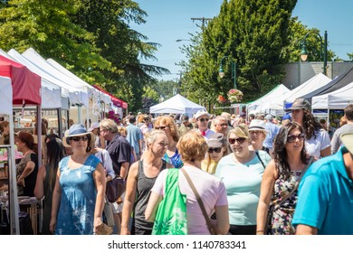 Delta, British Columbia / Canada - July 22nd 2018 - The Annual Ladner Village Market where thousands of people come to buy local produce and products. Many Tents and Vendors.