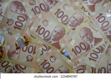 Delta, British Columbia / Canada - November 3rd 2018 - Many Canadian Hundred Dollar Bills in a Pile Close Up