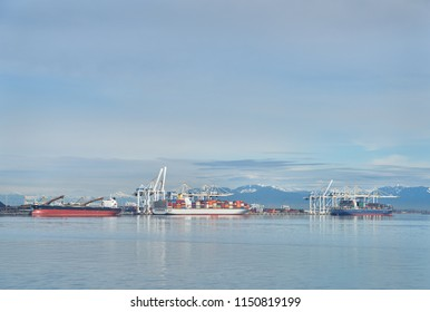 Delta Port Freighters, British Columbia. The industrial waterfront of Delta, British Columbia. British Columbia, Canada.