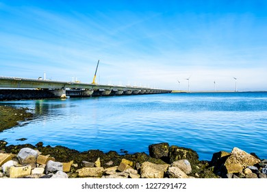 The Delta Works Storm Surge Barrier and Wind Turbines at the Oosterschelde viewed from Neeltje Jans island in Zeeand Province in the Netherlands