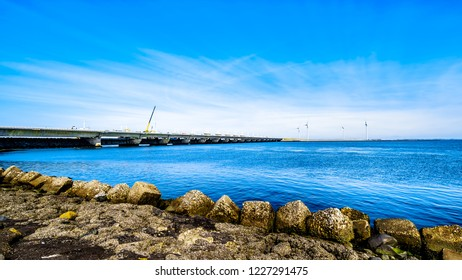 The Delta Works Storm Surge Barrier and Wind Turbines at the Oosterschelde viewed from Neeltje Jans island in Zeeland Province in the Netherlands