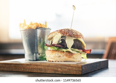 Deluxe burger and chips at upmarket restaurant.