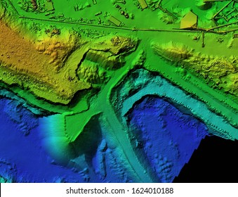 DEM - digital elevation model. GIS product made after proccesing aerial pictures taken from a drone. It shows mine with stockpiles that can be measures due to mapping