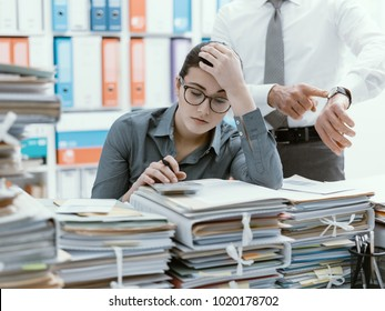 Demanding boss pointing to his watch and asking to his employee to hurry up, his secretary is frustrated and overwhelmed by work: business and deadlines concept