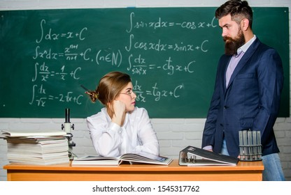 Demanding lecturer. Teacher strict serious bearded man having conflict with student girl. Man unhappy communicating. School principal talking about punishment. Conflict situation. School conflict.
