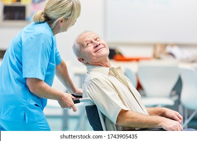 Demented senior in wheelchair is being cared for by a nurse in geriatric care