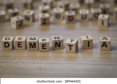 Dementia written in wooden cubes on a table from well ordered to chaotic