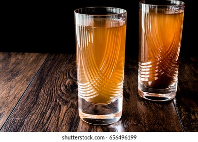 Demirhindi serbeti or sherbet / Tamarind Juice on dark wooden surface.