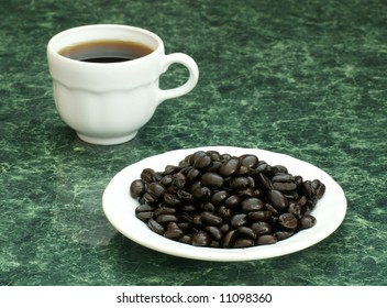 Demitasse with coffee and coffee beans