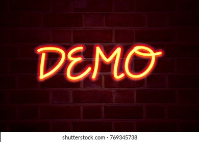 Demo neon sign on brick wall background. Fluorescent Neon tube Sign on brickwork Business concept for Software Demonstration 3D rendered