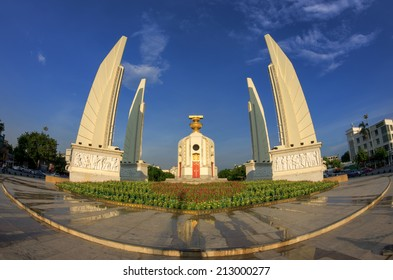The Democracy Monument beautiful sky There is a foreground flowers (Bangkok, Thailand).