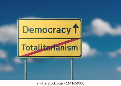 democracy totalitarianism  - yellow road sign