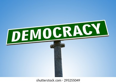 DEMOCRACY word on green road sign